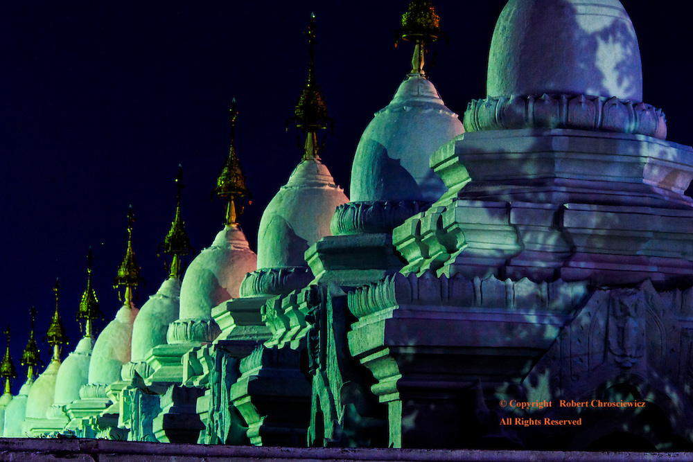 Mandalay Moon: The Kyauksa Gu at the Kuthodaw Pagoda is illuminated under the light of a full moon and becomes a feast of colour, Mandalay Myanmar.