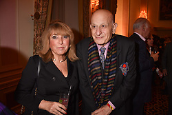Eve pollard and Naim Attallah at a reception to celebrate the publication on 'Mother Anguish' by Basia Briggs held in The Music Room, The Ritz Hotel, 150 Piccadilly, London, England. 04 December 2017.