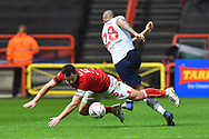 Bailey Wright (5) of Bristol City is challenged by Josh Magennis (28) of Bolton Wanderers during the The FA Cup fourth round match between Bristol City and Bolton Wanderers at Ashton Gate, Bristol, England on 25 January 2019.