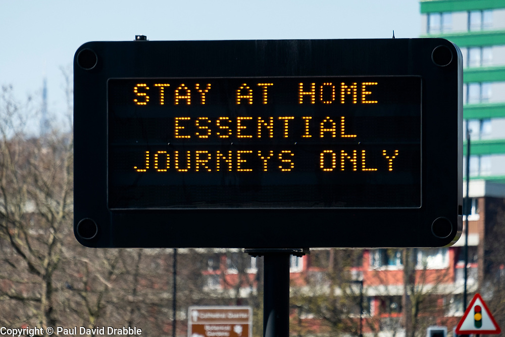 """Signs of the Coronavirus. <br /> """"Saint Mary's Gate Sheffield Essential Journey Only"""". Third day emergency measures which were announced by Prime minister Boris Johnson on Monday evening (23rd march)<br /> <br /> 26 March 2020<br /> <br /> www.pauldaviddrabble.co.uk<br /> All Images Copyright Paul David Drabble -<br /> All rights Reserved -<br /> Moral Rights Asserted -"""