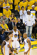 Rapper E-40 watches the Golden State Warriors take on the Cleveland Cavaliers during Game 1 of the NBA Finals at Oracle Arena in Oakland, Calif., on June 1, 2017. (Stan Olszewski/Special to S.F. Examiner)
