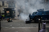 Protesters trying to block an armored vehicule. More than 125000 gathered in Paris for the Gilets Jaune (Yellow vest) protest. Soon the protest turned violent an protesters clashed with the police, tear gas and flash bombs were fired, many injured and arrested by the police. Paris December 6th 2018. Federico Scoppa