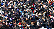The crowds on the mall listen to  the swearing in ceremony during the Inauguration on January 20, 2009.  Photograph:  Dennis Brack