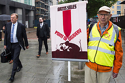 London, UK. 14th September, 2021. A Quaker holds a banner at a Stop The Arms Fair protest outside ExCeL London on the first day of the DSEI 2021 arms fair. Activists from a range of different groups have been protesting outside the venue for one of the world's largest arms fairs for over a week.