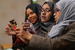 From left, Hibo Omar, Muhubo Shire and Kin Kyani watch results for Minnesota's Fifth Congressional District at Omar's election night headquarters in Minneapolis on Tuesday, November 6, 2018. Photo by Mark Vancleave/Minneapolis Star Tribune/TNS/ABACAPRESS.COM