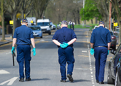 April 17, 2018 - London, England, United Kingdom - Police officers look for evidence at the scene of a stabbing in Forest Gate. A teenager has been stabbed to death in an east London street bringing the capital's death toll this year up to 60. (Credit Image: © Gustavo Valiente/i-Images via ZUMA Press)