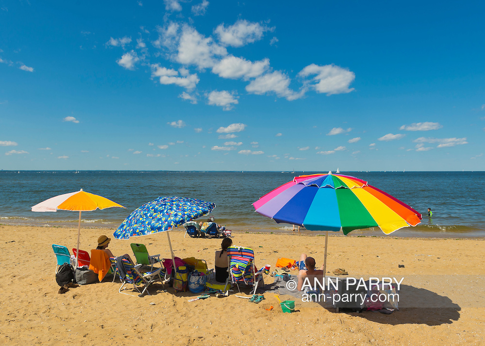 Sands Point, New York, U.S. - July 5, 2014 - During July 4th holiday weekend, people visit the Shoreline at Sands Point Preserve on the Gold Coast along Long Island Sound, when sunny warm weather arrives after a July 4th with many events canceled due to rain.