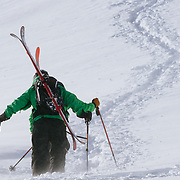 Sam Sehnert and Ethan Valenstein hike towards Powder 8 face off of Cody Peak in the Jackson Hole backcountry.