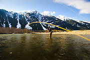 Dean Gallacher starts another spey cast while fishing for winter steelhead on BC's Skeena River.