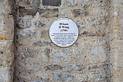 Oxford Preservation Trust sign on a stone wall marking Prison D Wing of the old Prison which initially was a medal castle and has now been converted into Malmaison Hotel. William Blackburn designed the prison D Wing in 1790.