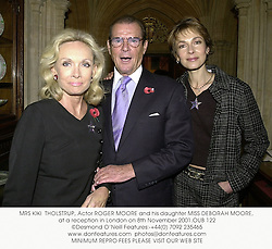 MRS KIKI  THOLSTRUP, Actor ROGER MOORE and his daughter MISS DEBORAH MOORE, at a reception in London on 8th November 2001.OUB 122