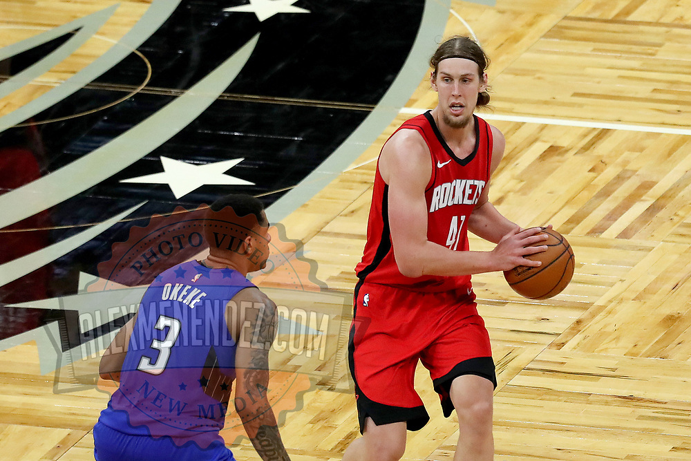 ORLANDO, FL - APRIL 18: Kelly Olynyk #41 of the Houston Rockets controls the ball in front of Chuma Okeke #3 of the Orlando Magic  at Amway Center on April 18, 2021 in Orlando, Florida. NOTE TO USER: User expressly acknowledges and agrees that, by downloading and or using this photograph, User is consenting to the terms and conditions of the Getty Images License Agreement. (Photo by Alex Menendez/Getty Images)*** Local Caption *** Kelly Olynyk; Chuma Okeke