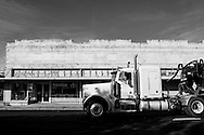 A truck carrying salt water, used in natural gas drilling, rolls through the center of Mansfield, Louisiana. Independent oil and gas producers that drill most of the wells in the United States have created the technology to extract natural gas from shale rock at an economic price, transforming the natural gas scene along with small communities in Texas and Louisiana.