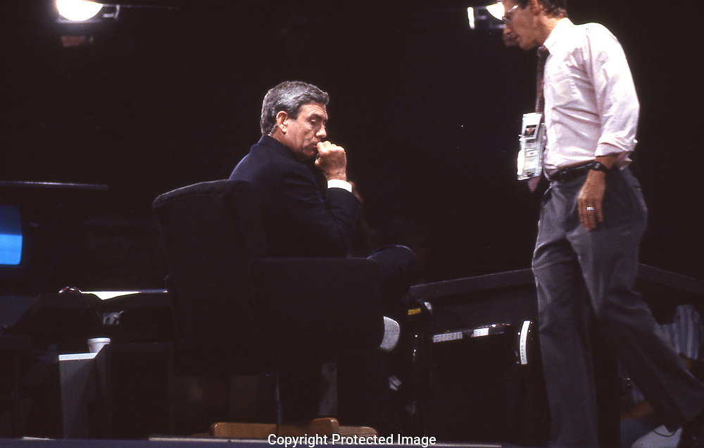 Dan Rather in the CBS anchor booth  during an off air moment  of the 1988 Democratic Convention. <br /><br />Photograph ny Dennis Brack. bb78