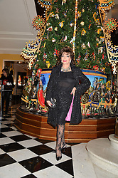 JOAN COLLINS at the Claridge's Christmas Tree By Dolce & Gabbana Launch Party held at Claridge's, Brook Street, London on 26th November 2013.