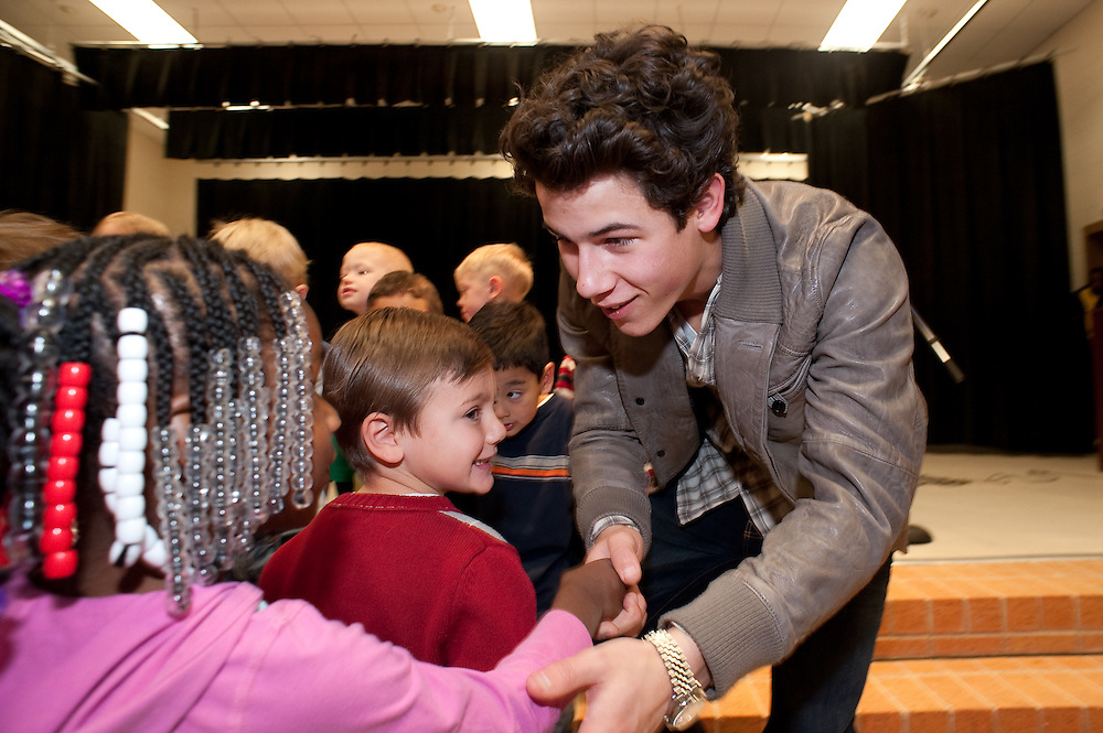 """Mark Matson For USO (12/11/09)  The USO hosted a """"Community Strong"""" event at Ft. Hood, Friday December 11, 2009. Singer Nick Jonas made an appearance at Meadows Elementary School. Jonas reached out to the students and alos posed for photos with each class."""
