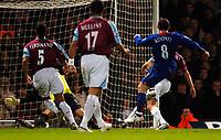 Photo: Daniel Hambury.<br />West Ham United v Manchester United. The Barclays Premiership. 27/11/2005.<br />Manchester's Wayne Rooney dances through the West Ham defence to score.