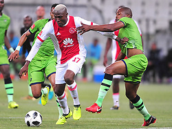 Cape Town 180112  Ajax Cape Town striker Tendai Ndoro pulled back by Gift Sithole of Platinum Stars as he is about to take a shot at goalkeeper Dino Visser in the PSL match at Cape Town Stadium  .  Picture:Phando Jikelo/African News Agency(ANA)