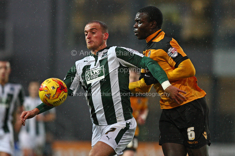 Lewis Alessandra of Plymouth Argyle shields the ball away from Ismail Yakubu of Newport County (r). Skybet football league two match, Newport County v Plymouth Argyle at Rodney Parade in Newport, South Wales on Boxing Day, Friday 26th December 2014<br /> pic by Mark Hawkins, Andrew Orchard sports photography.
