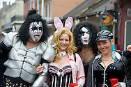Four Fat Tuesday revelers pause on Bourbon Street, dressed up with a Kiss theme as they celebrate the final day of Mardi Gras in New Orleans, Louisiana.