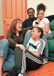 Couple with their two foster children, London UK