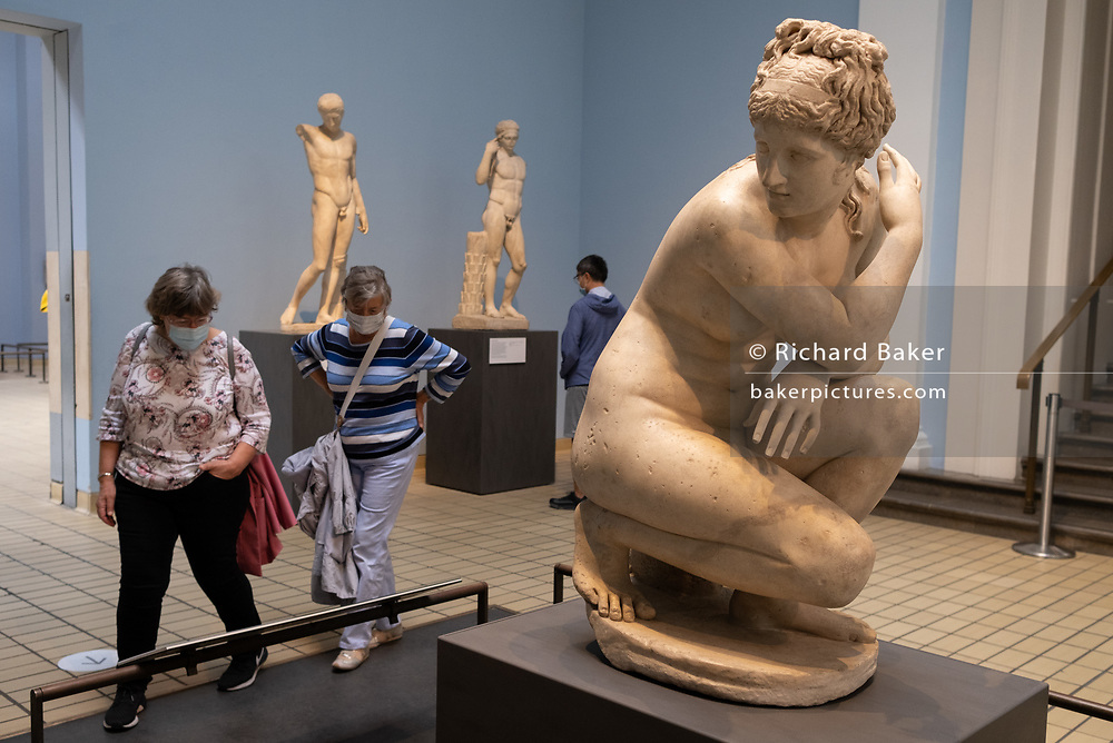 Now re-opened after months of closure during the Coronavirus pandemic, some of the first visitors who have pre-booked free tickets, once again enjoy Lely's Venus (Aphrodite) the historical artifacts at the British Museum, on 2nd September 2020, in London, England. Naked Aphrodite was a popular subject with ancient Greek sculptors as she was with the Romans who called her Venus. This statue is a Roman copy of the Greek original, probably made in the 1st or 2nd century.