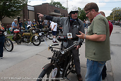 Chris Tribbey checks in at the end of another long day of riding his 1911 Excelsior model-K single-cylinder Class-1 bike in the Motorcycle Cannonball coast to coast vintage run. Stage 7 (274 miles) from Cedar Rapids to Spirit Lake, IA. Friday September 14, 2018. Photography ©2018 Michael Lichter.