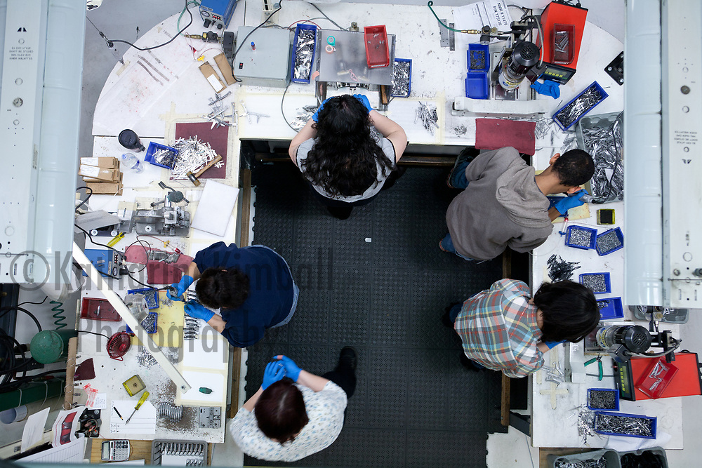 Employees at Leatherman work together to assemble the Squirt PS4 Keychain Tool.