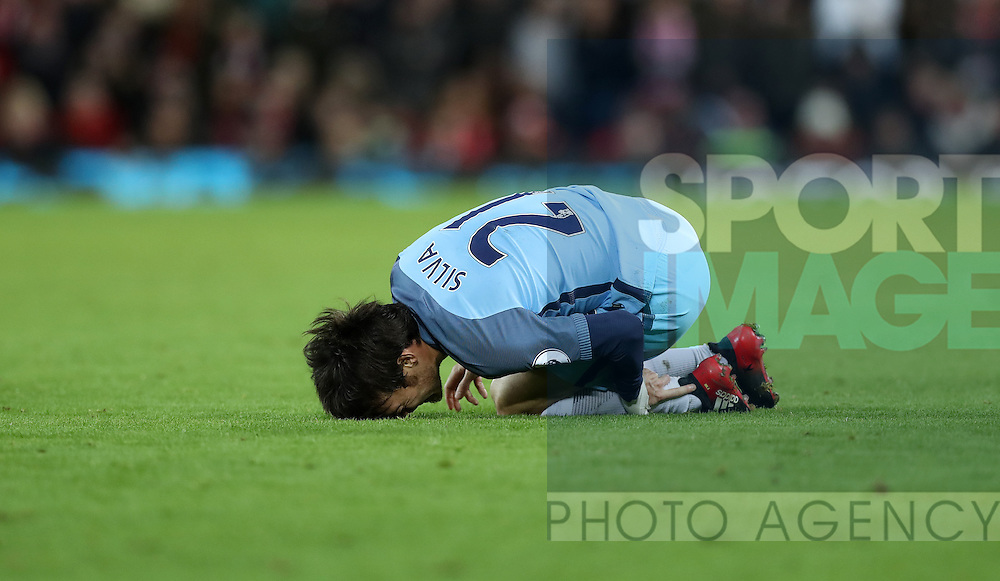 David Silva of Manchester City is injured during the English Premier League match at Anfield Stadium, Liverpool. Picture date: December 31st, 2016. Photo credit should read: Lynne Cameron/Sportimage