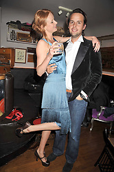 OLIVIA INGE and CHARLIE GILKES at a party for Glenmorangie hosted at Barts,  Sloane Avenue, London on 26th March 2009.