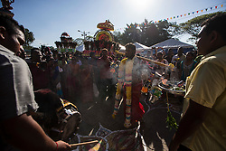 © Licensed to London News Pictures. 24/01/2016 Ipoh, Malaysia. A devotee carrying two pots of milk arrives at Kallumalai Murugan Temple in Ipoh, Malaysia, during the Thaipusam Festival, Sunday, Jan. 24, 2016. Photo credit : Sang Tan/LNP