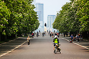 People cycle and jog along Greenwich Park in London, Sunday, May 10, 2020 during the nation-wide coronavirus lockdown. Personal exercise while observing social distancing measures is allowed under government lockdown guidelines. (Photo/ Vudi Xhymshiti)