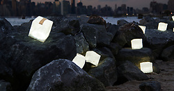 August 3, 2017 - inconnu - A solar-powered lamp inspired by the inventor's love of origami is bringing light to remote Third World communities and disaster zones.The collapsible SolarPuff by Solight Design is also an eco-friendly alternative to kerosene lanterns in an effort to reduce pollution.It was created by designer Professor Alice Chun after seven years of research.The flat-pack light is made of a recyclable sailcloth material and 10 bright LEDs that charge in the sun, resulting in 8-12 hours of light. There are three settings: low, high, and blinking for relief or distress. The light is waterproof and floats, and can withstand most climates. To activate it, users simply twist and pull up and use a slight push to deflate.Through Professor Chun's charitable organisation, Focus of Architecture Art Relief Making, she helps needy communities around the globe through sustainable design and architectural solutions that will better their society, reduce pollution.It was created to be helpful in communities with no electricity, refugee camps, disaster or war zones, and other locations where pollutants are the only alternative.Prof Chun said she wanted to solve an important issue where more than a billion people around the world still don't have good access to reliable and proper lighting. Combining her knowledge, and her love for origami, the Japanese art of paper folding , the inflatable lamp was born.It is also great for campers and hikers.Each lamp costs around $30 USD / €25 Euros / £22 GBP # LAMPE A ENERGIE SOLAIRE (Credit Image: © Visual via ZUMA Press)