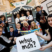 Picture shows: .George Wyllie's daughter, Louise Wyllie, pictured centre with school pupils from nine local authorities across the west of Scotland who have been participating in the George Wyllie Education Initiative.....GEORGE WYLLIE RETROSPECTIVE: .IN PURSUIT OF THE QUESTION MARK..ARTIST'S LIFE LESS ORDINARY ON SHOW..THE life and work of George Wyllie, MBE, who died in May this year at the age of 90, is the subject of In Pursuit of the Question Mark, which is being curated by his elder daughter, Louise Wyllie...The exhibition is the most comprehensive survey of the internationally renowned Glasgow-born artist's work ever mounted and consists of almost 1000 objects. These range from his earliest drawings made for family when he was serving on HMS Argonaut in The Pacific during the Second World War, to his Cosmic Bunnet, made for his last ever solo exhibition in 2005...Wyllie described himself as a 'scul?tor' because, he said, the question mark should always be at the centre. His ambition as an artist, writer and philosopher was to bring art to the attention of the wider world with an engaging, and often humorous take on his chosen subjects...Some of the artist's earliest sculptural work has also been tracked down. This includes a Bumper Dolphin, made from old car bumpers, dating to the 1960s, and a peacock made from washers and scrap metal...The exhibition also features material which shows the process which led Wyllie to create iconic ephemeral works such as the Straw Locomotive and the Paper Boat...The Whysman Festival received funding from First in a Lifetime/Year of Creative Scotland 2012 to mount this exhibition and project-manage two community based projects; The Big Little Paper Boat Education Initiative which takes in over 90 Clydeside schools and the Big Clyde Question Project involving community groups in Inverclyde...GEORGE WYLLIE RETROSPECTIVE: IN PURSUIT OF THE QUESTION MARK.The Mitchell, North Street, Glasgow, G3 7DN.www.whysman.co.uk.3 November,