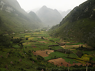 Mountainous landscape. Jungle mostly covers mountains. Paddy fields with rice plantation is a vital component in subsistence of local people. Cao Bang province, Vietnam, Asia