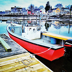 A small boat in Portsmouth Harbor, Portsmouth, New Hampshire.