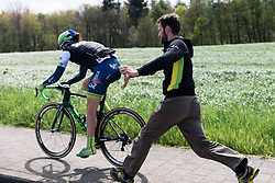 Quick bike change for Sarah Roy (Orica AIS) after a crash at Dwars door de Westhoek 2016. A 127km road race starting and finishing in Boezinge, Belgium on 24th April 2016.