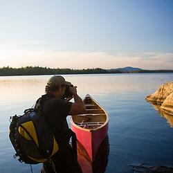 A photographer on Seboeis Lake near Millinocket, Maine.
