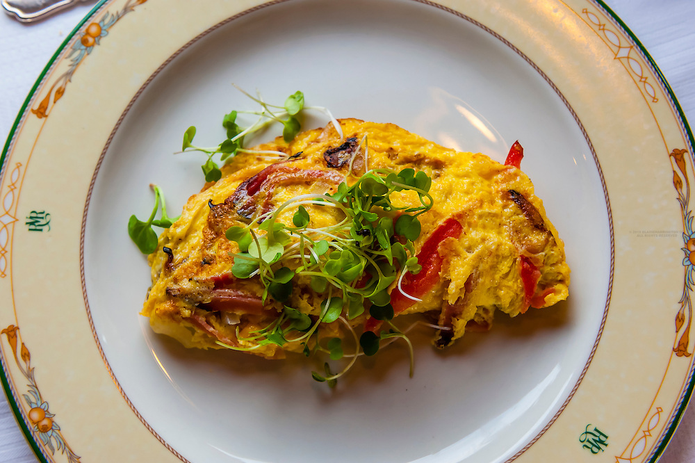 A breakfast omelette of Black Forest Ha, Ambutho cheese, onions, mushrooms and tomatoes on the luxury Rovos Rail train journey from Pretoria to Cape Town, South Africa.