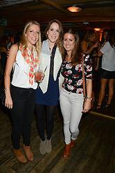 Left to right, HELEN BURKITT, RACHEL BURKITT and FRANCESCA CADONI at 'Bodo's Schloss Goes Wild For Lewa' held at Bodo's Schloss, 2A Kensington High St, London W8 on 9th October 2013.