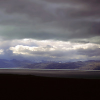 South America, Chile, Magallanes. Skyscape and landscape of dancing clouds and light on the Magallenic coast.