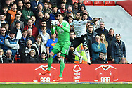 Nottingham Forest goalkeeper Costel Pantilimon (1) makes the ball safe with Derby County midfielder Bradley Johnson (15) during the EFL Sky Bet Championship match between Nottingham Forest and Derby County at the City Ground, Nottingham, England on 11 March 2018. Picture by Jon Hobley.