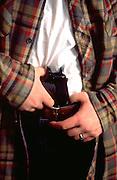 Man age 21 holding 45 pistol in his belt MR.  St Paul Minnesota USA