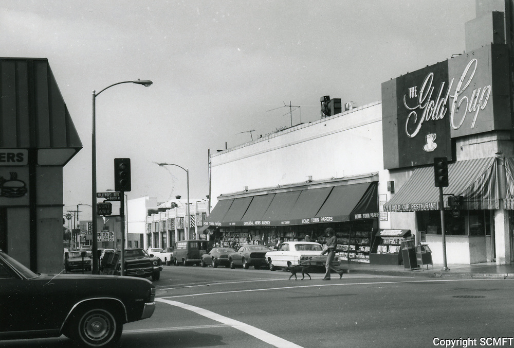 1973 Gold Cup Restaurant and Universal News Stand on SW corner of Hollywood Blvd. & Las Palmas Ave.