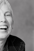 Mature woman laughing, portrait, close-up, detail (B&W).