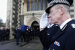"""©Licensed to London News Pictures  17/01/2014<br /> The funeral of PC Kevin Arnold """"Arnie"""" who died due to cancer took place in Croydon. A typical police send off starting at Mitcham Road Barracks, along Roman Way over the flyover to Reeves Corner then on to Croydon Minster.<br /> Photo Credit:  Presspics/LNP"""
