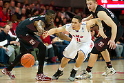 DALLAS, TX - FEBRUARY 6: Nic Moore #11 of the SMU Mustangs dribbles between Quenton DeCosey #25 and Dalton Pepper #32 of the Temple Owls on February 6, 2014 at Moody Coliseum in Dallas, Texas.  (Photo by Cooper Neill) *** Local Caption *** Nic Moore; Quenton DeCosey; Dalton Pepper