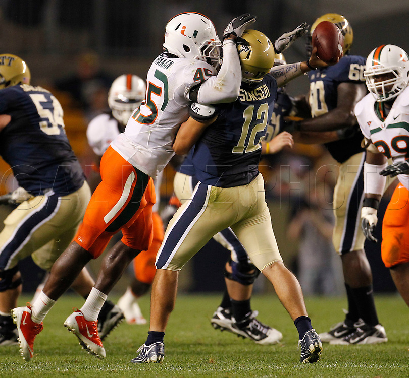 Miami Hurricanes linebacker Ramon Buchanan (45) puts pressure on Pittsburgh Panthers quarterback Tino Sunseri (12) in the second half during The University of Miami  vs The University of Pittsburgh Panthers at Heinz Field in Pittsburgh, PA, on Thursday, September 23, 2010.