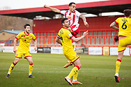 Matthew Sadler of Walsall and Elliott List of Stevenage as he tries to score a goal with a header during the EFL Sky Bet League 2 match between Stevenage and Walsall at the Lamex Stadium, Stevenage, England on 20 February 2021.