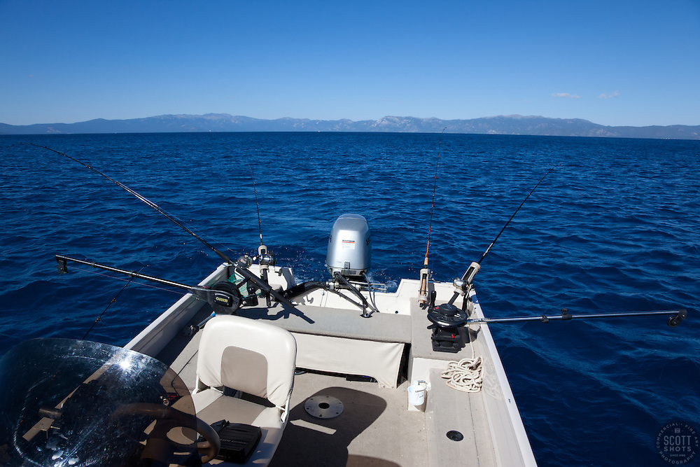 """""""Fishing Boat on Lake Tahoe 4"""" - This fishing boat with many fishing poles was photographed near the West shore of Lake Tahoe, California."""